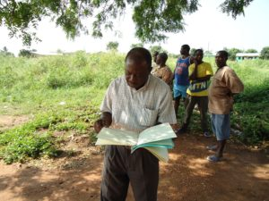 Emmanuel checking the document