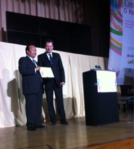 Prem Rawat receives an award at his first speaking event inside Russia. at Synergi University