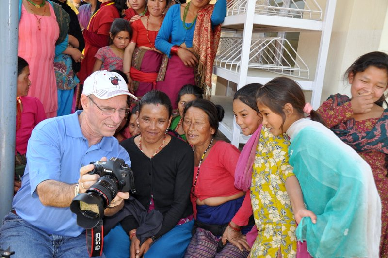 Bruce Keenan (left) Having Fun With Villagers