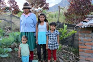 Cruz Maria Lopez With Grand Daughters in Her Garden