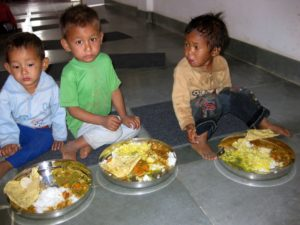 3 boy eating