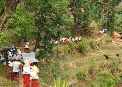 Residents take their supplies back to their homesites in Sindhupalchok.