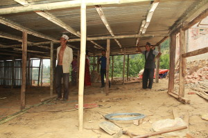 A shelter being built using metal sheets provided by TPRF