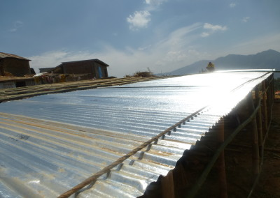 A shelter being built using metal sheets provided by TPRF.