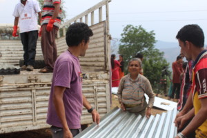 Metal roofing sheets distributed to people who lost their homes for building shelters
