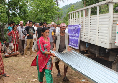 Metal roofing sheets distributed to build shelters ahead of monsoon season.