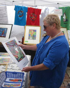 A customer looks at one of Tangerine Meg's calendars